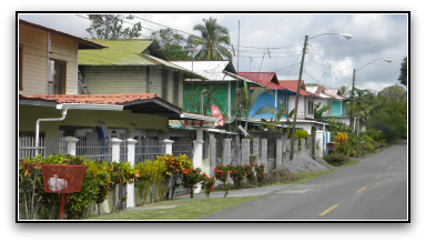 2 story wooden buildings along asphalt road