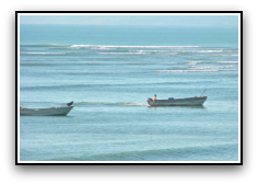 fishing boats on a blue ocean