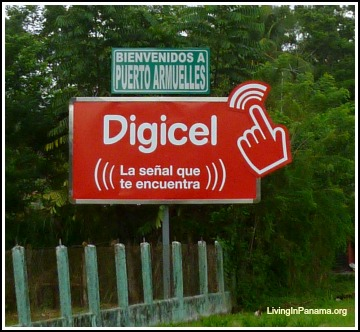 Welcome to Puerto Armuelles sign on top of bigger red Digicel sign